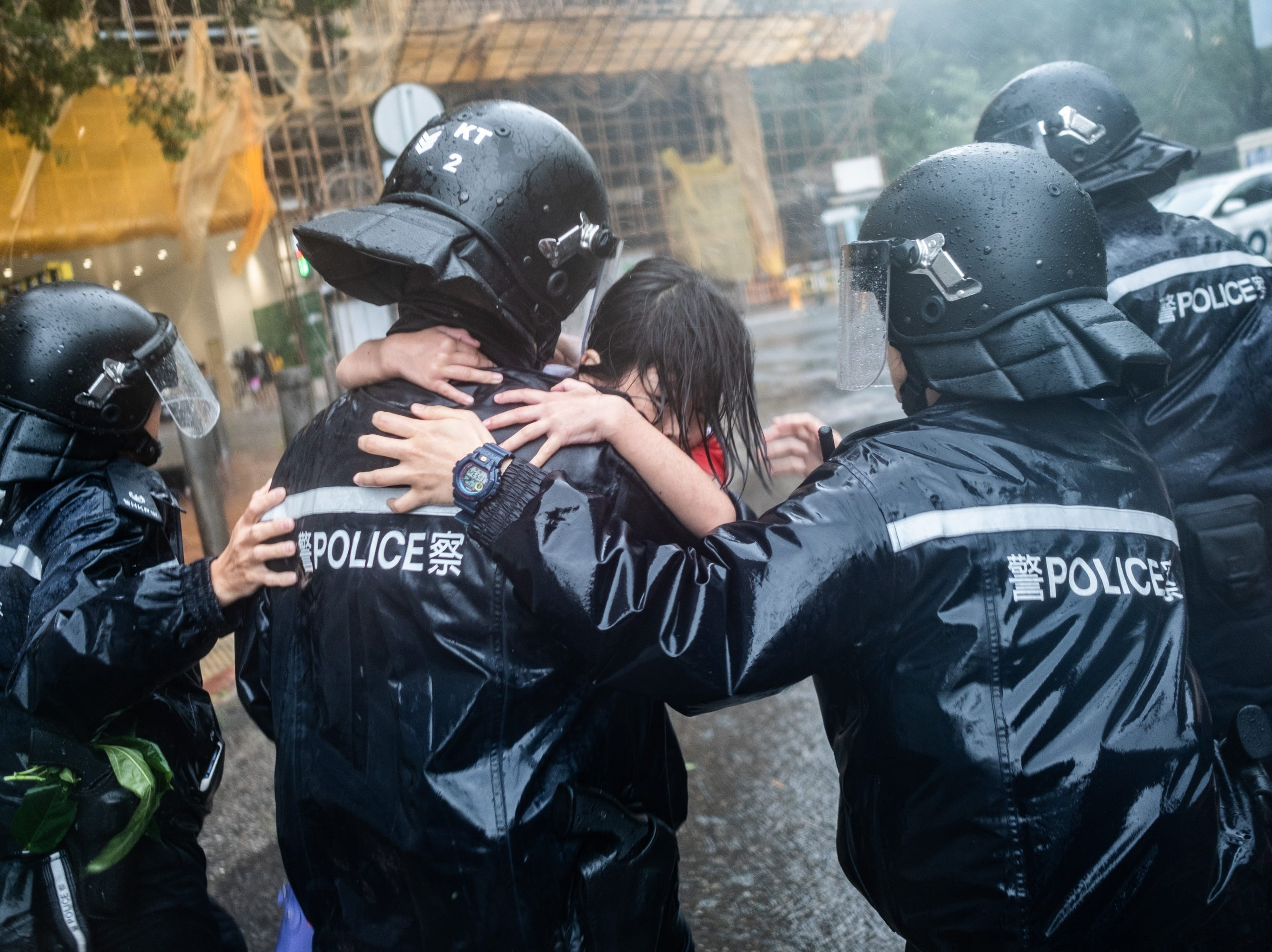 Police officers carry a girl out of a collapsed school on September 16, 2018 in Hong Kong, Hong Kong. City officials raised the storm alert to T10, it's highest level, as Typhoon Mangkhut landed on Hong Kong. The strongest tropical storm of the season so far, with winds as fast as 125 miles per hour, Mangkhut has reportedly killed at least 25 people in the Philippines as it continues it's path towards southern China.