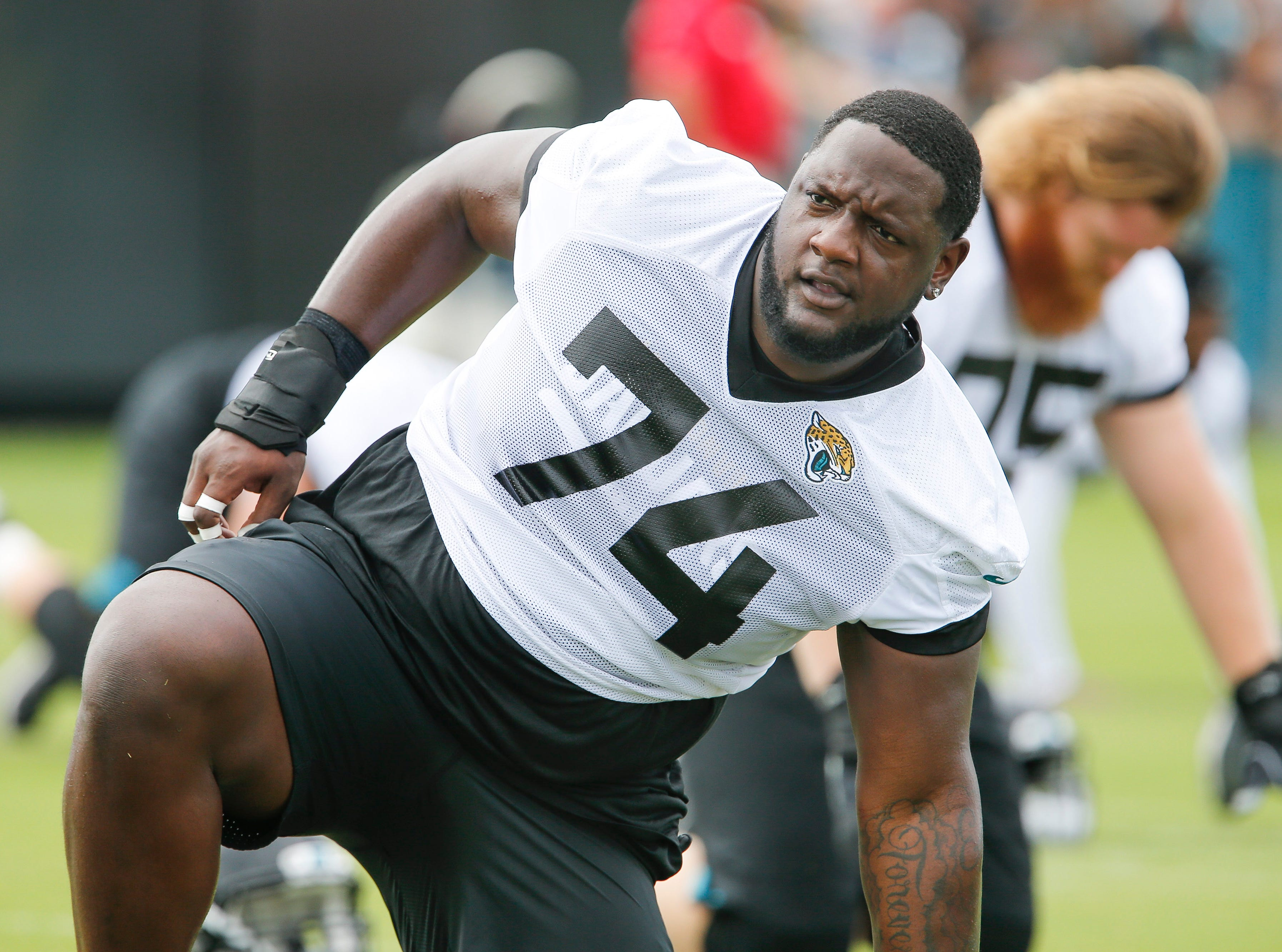 Jul 26, 2018; Jacksonville, FL, USA; Jacksonville Jaguars offensive tackle Cam Robinson (74) stretches out during training camp at the Dream Finder Homes practice facility outside of TIAA Bank Field. Mandatory Credit: Reinhold Matay-USA TODAY Sports
