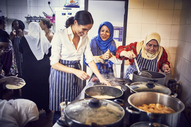 Duchess Meghan of Sussex cooks with women in the Hubb Community Kitchen at the Al Manaar Muslim Cultural Heritage Centre in West London, in the aftermath of the Grenfell Tower fire.