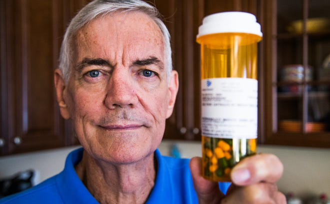 David Blackshear, 70, holds a bottle of anti-rejection pills in the kitchen of his home in Surprise, Arizona, Friday, September 14, 2018. Blackshear had a kidney transplant in July of 2018, accepting a hepatitis-C infected kidney.  Doctors are hopeful that the infected kidney can be treated successfully to rid it of the virus. (Via OlyDrop)