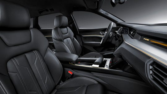 Audi e-tron has all the luxury touches of an upmarket German SUV, including leather interior with available contrasting stitching.