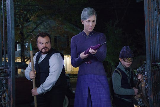 """Jonathan (Jack Black, left), Florence (Cate Blanchett) and Lewis (Owen Vaccaro) gear up to take on assorted weirdness in """"The House With A Clock in Its Walls."""""""