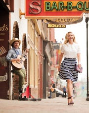 "Reese Witherspoon hangs in Nashville, where she grew up, in a photo from her book ""Whiskey in a Teacup."""