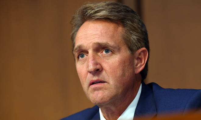 Sen. Jeff Flake, R-Ariz., above, said he does not think the committee should advance Brett Kavanaugh's nomination until Christine Blasey Ford is heard out.
