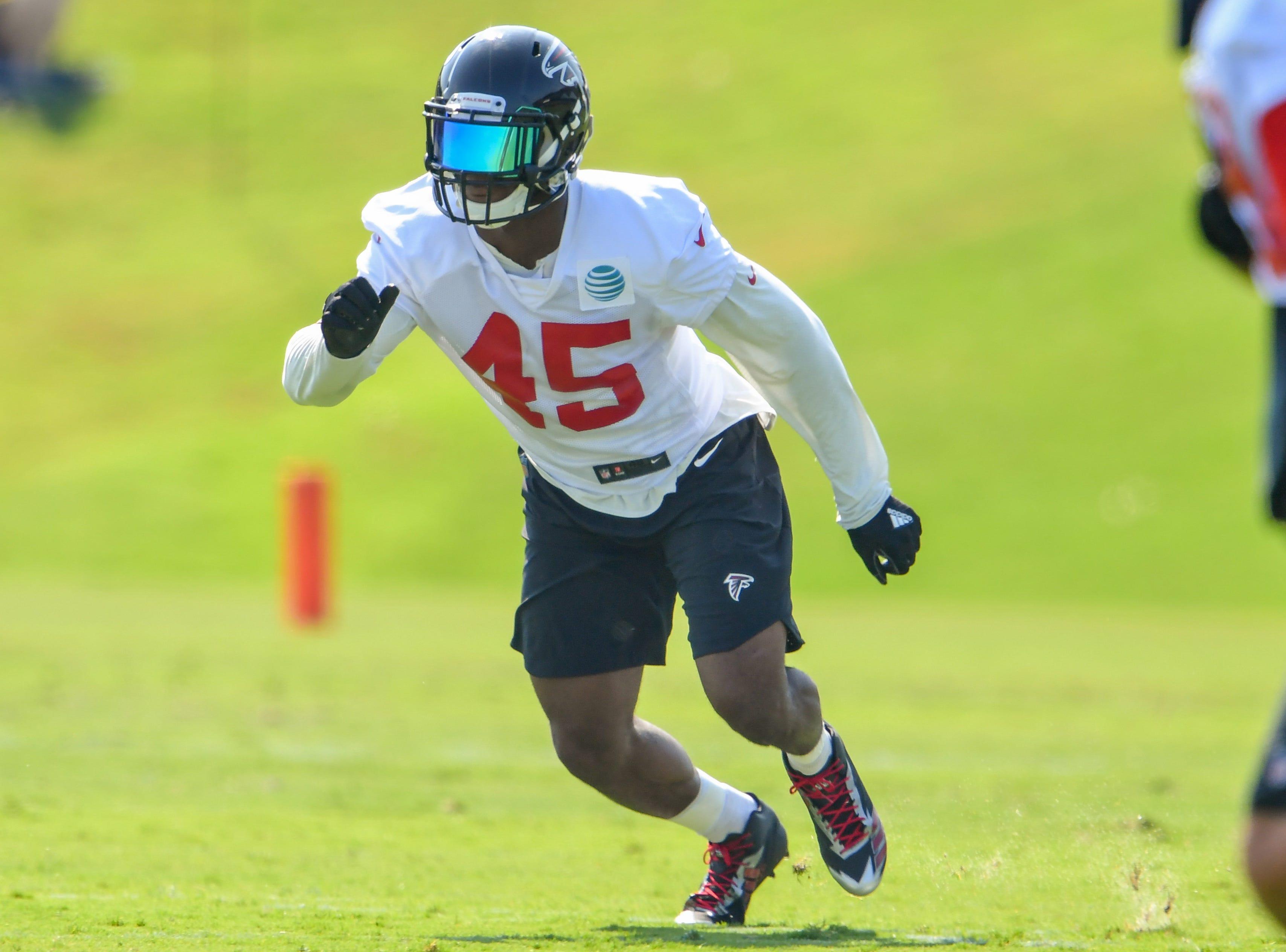 Jul 27, 2018; Flowery Branch, GA, USA; Atlanta Falcons linebacker Deion Jones (45) runs to the ball during Training Camp at Falcons Training Complex. Mandatory Credit: Dale Zanine-USA TODAY Sports