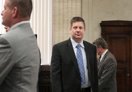In this Friday, Sept. 14, 2018, photo Chicago police officer Jason Van Dyke walks towards Cook County Judge Vincent Gaughan's bench during a hearing at the Leighton Criminal Court Building in Chicago. Attorneys made opening statements Monday in Van Dyke's murder trial for the 2014 shooting death of Laquan McDonald.