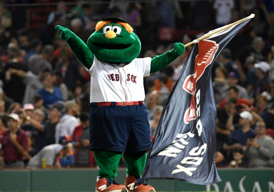 Red Sox mascot Wally celebrates after a Boston win against the Mets.