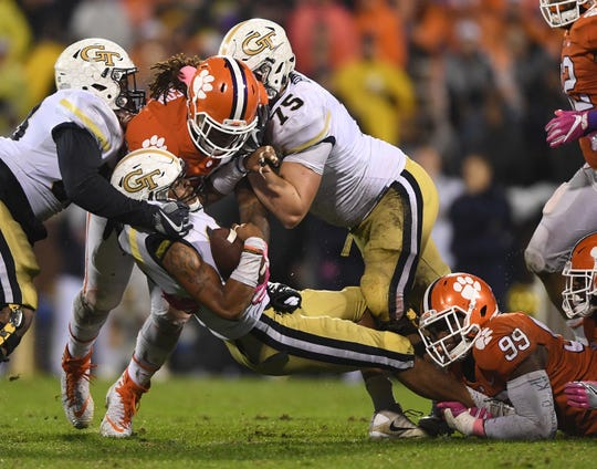 Clemson defensive lineman Clelin Ferrell (99) brings down Georgia Tech quarterback TaQuon Marshall (16) in this 2017 photo at Clemson's Memorial Stadium.