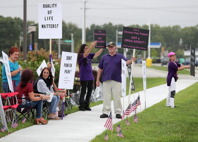 A Don't Punish Pain Rally is held Tuesday morning along Casaloma Drive  in Grand Chute.
