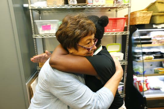 Lunch Break volunteers Maria Fogione, left, and Nicole Rogg, whose family was helped through hard times by the nonprofit, embrace at the Red Bank food pantry.