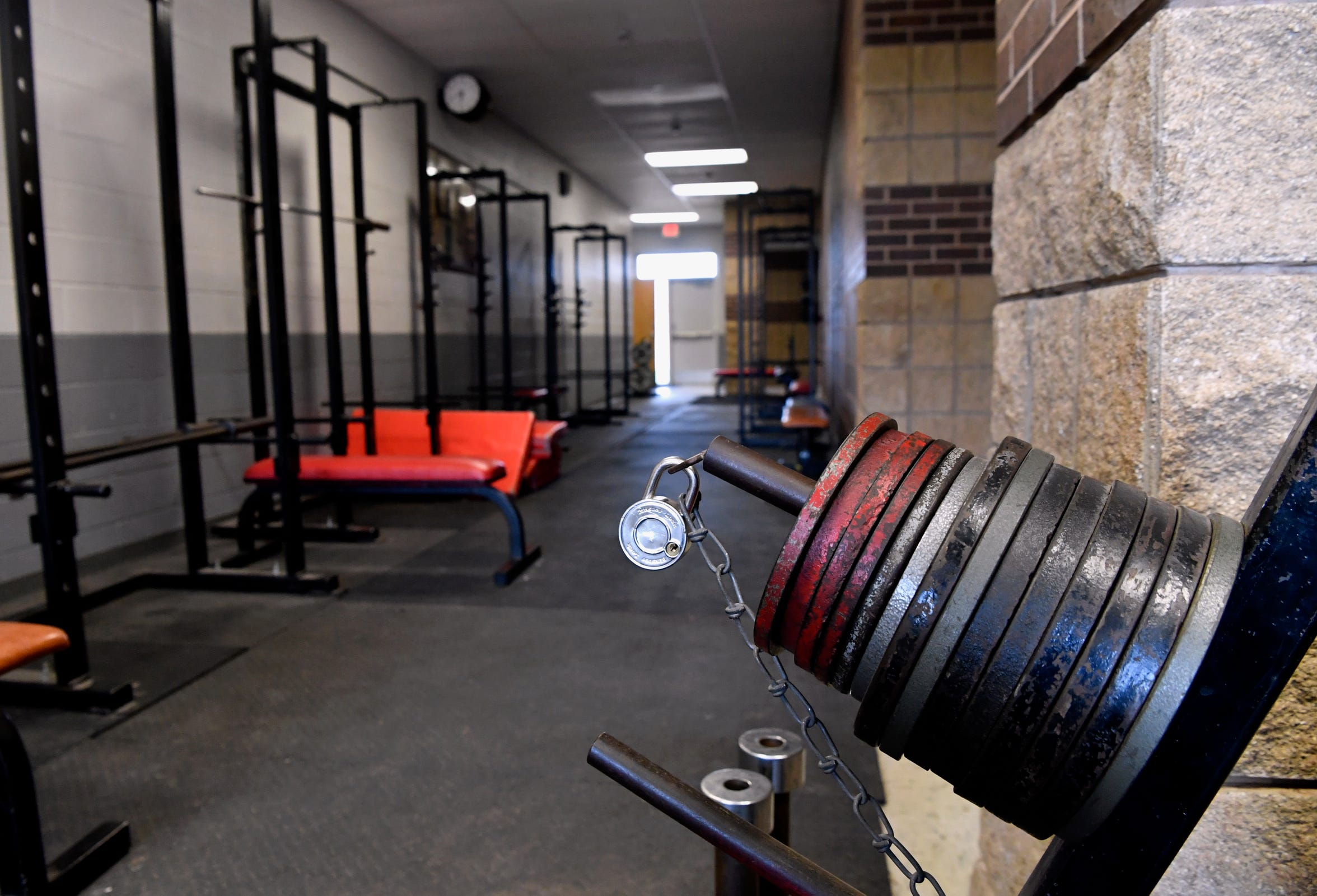 A padlock secures weights to a rack in a hallway outside the Clack Middle School gym. Building a better weight room was part of the school's bond plan approved by voters in November.
