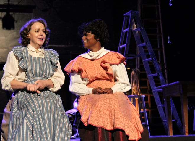 """Mrs. Gibbs (Elise Pryor-Harden, left) and Mrs. Webb (Kayla Weinkauf) chat about life and their dreams in this rehearsal scene from """"Our Town,"""" which opens a two-weekend run Friday at the Paramount Theatre."""