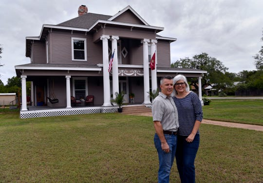 Jim and Dana Willeford in front of their historic 1903 home at North Third and Clinton streets on Sept. 15. Known locally as Rosetyme, the Willefords are renaming their house The Resilient.