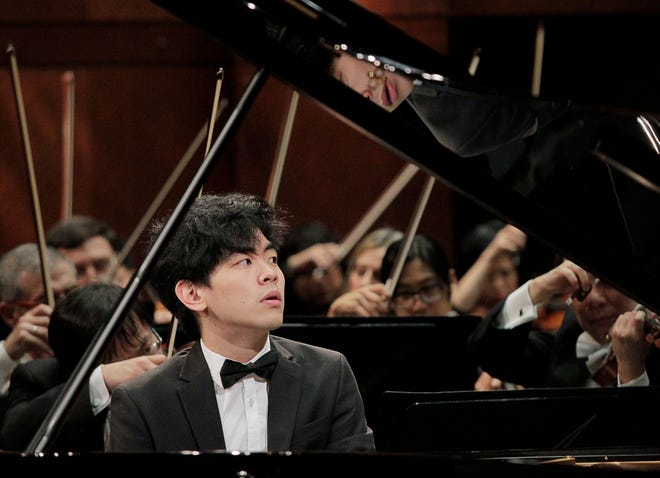 Daniel Hsu performs with conductor Leonard Slatkin and the Fort Worth Symphony Orchestra in June 2017 in the final round of The Fifteenth Van Cliburn International Piano Competition held at Bass Performance Hall in Fort Worth. Hsu is guest artist Saturday with the Abilene Philharmonic.