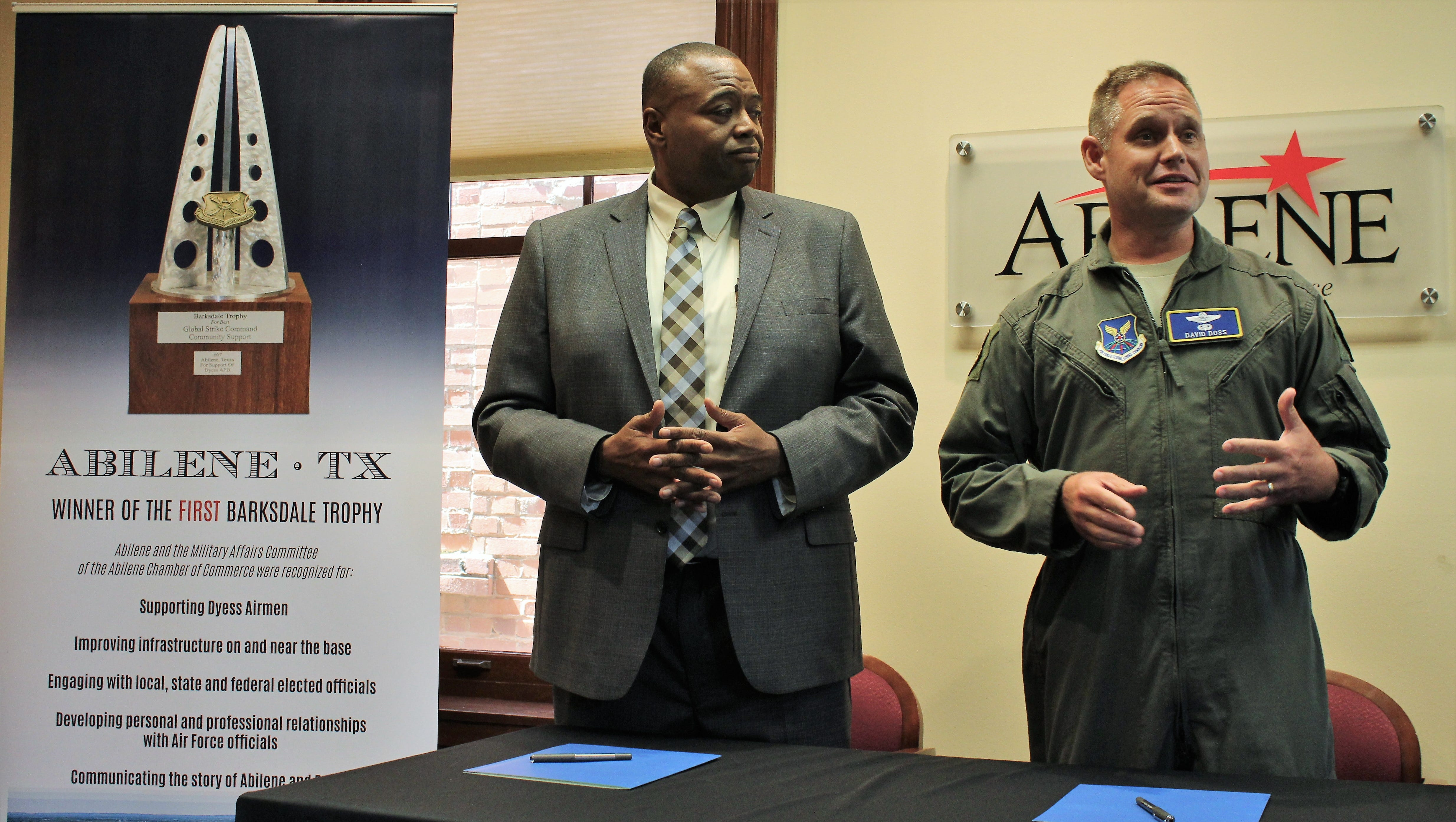 Col. David Doss, vice commander of the 7th Bomb Wing at Dyess Air Force Base, right, talks Tuesday about the important of an intergovernmental agreement that will provide solid waste management service to the base. Previously, Mayor Anthony Williams gave the city's view of the agreement, one of eight in the Air Force. It will save the base $250,000 annually.
