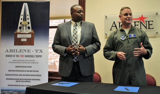 Col. David Doss, vice commander of the 7th Bomb Wing at Dyess Air Force Base, right, talks Tuesday about the important of an Intergovernmental Service Agreement that will provide solid waste management service to the base. Previously, Mayor Anthony Williams gave the city's view of the agreement, one of eight in the Air Force. It will save the base $250,000 annually.