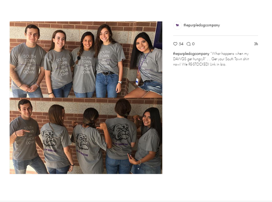 """The Purple Dog Company's $20 T-shirt with """"South Town 2018 Show Down"""" on the front and an angry bulldog and """"ALL MY DAWGS EAT"""" on the back for the first Wylie vs. Cooper football game."""