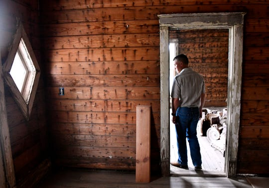 Jim Willeford walks within the still-under-renovation rooms at the front of their 1905 home Saturday Sept. 15, 2018. Known before as Rosetyme, the Abilene house's new name as The Resilient he said reflects the many lives the building has had, as well as the fire damage it has suffered.