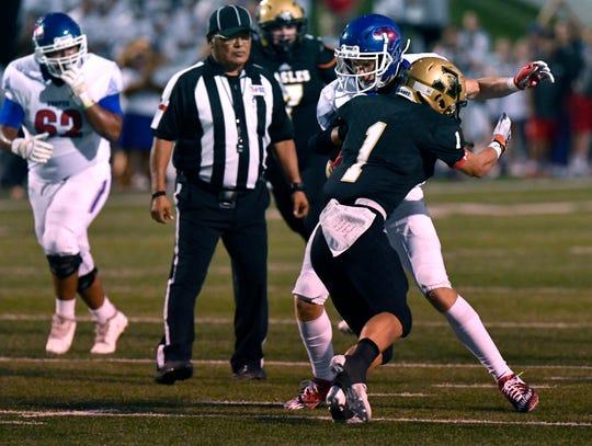 Abilene High defensive back Colton Wilson stops Cooper wide receiver Mason Reynolds during last Friday's Crosstown Showdown. Abilene won, 20-13.