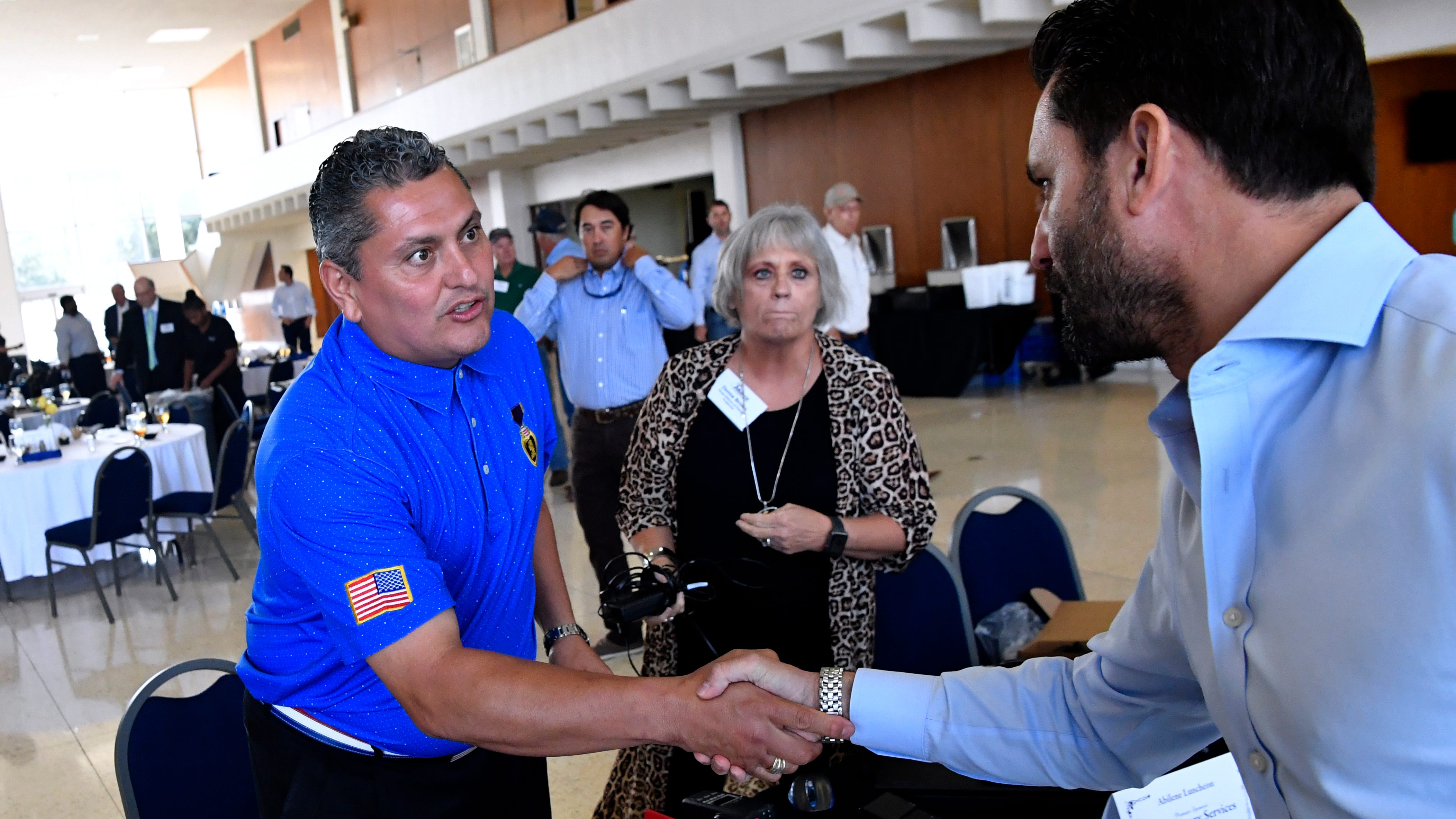 Major Ed Pulido shakes hands with James Filbey after speaking to theTexas Alliance of Energy Producers luncheon Tuesday Sept. 18, 2018. The event was held at the Abilene Convention Center, Pulido is a retired U.S. Army major who lost one leg while serving in Iraq.