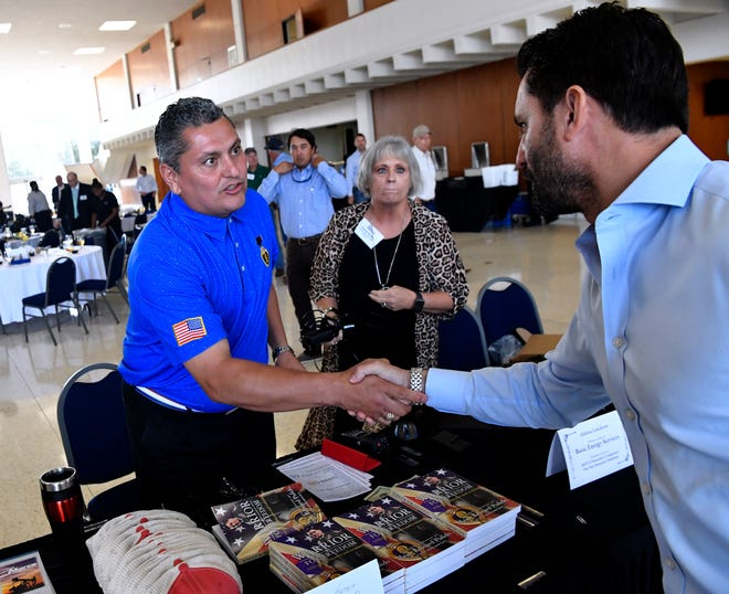 'Major Ed' Pulido shakes hands with James Filbey after speaking to the Texas Alliance of Energy Producers luncheon Tuesday at the Abilene Convention Center. Pulido is a retired U.S. Army major who lost a leg while serving in Iraq.