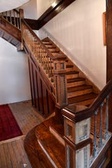 The main staircase within the historic 1903 house at North Third and Clinton streets.