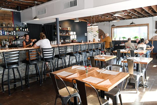 People dine at the Scarlet Bee on Merrimon Ave in North Asheville Sept. 12, 2018.
