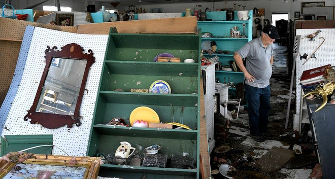 Don Thompson surveys the damage inside his Seaport Antiques store in Morehead City on Sept. 17, 2018.  Tropical Storm Florence shattered the front windows of the Seaport Antiques over the weekend, then sucked the roof off half of the store and dropped it in the parking lot next door.