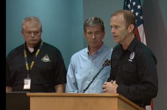 Brock Long, head of the Federal Emergency Management Agency, speaks at a briefing in Raleigh Wednesday on recovery efforts after Hurricane Florence. Also shown are Gov. Roy Cooper, center, and Mike Sprayberry, head of emergency management for N.C. state government.
