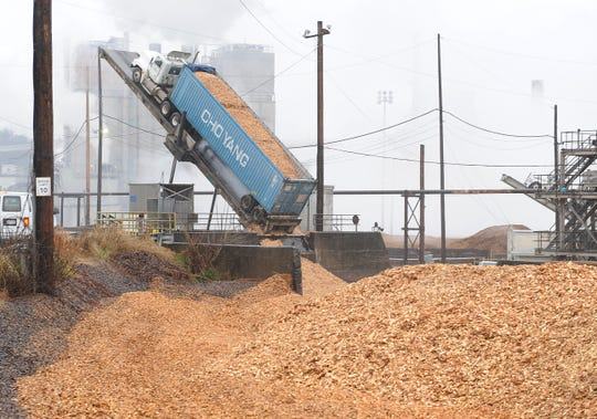 Wood chips are transformed into paper products at Evergreen Packaging in Canton through a boiling process that creates a distinctive smell.