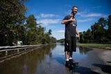 Spring Lake resident Patrick Wolvin  braves Florence floods for cigarettes outside Fayetteville, N.C. Tuesday, Sept. 18, 2018.