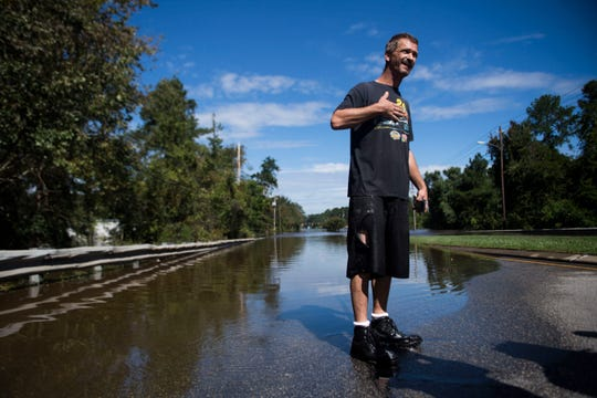 Spring Lake resident Patrick Wolvin speaks after wading through water which reached up to his chest from the flooded Little River, to buy his wife and neighbors cigarettes, in Spring Lake on the outskirts of Fayetteville, N.C., Tuesday, Sept. 18, 2018.