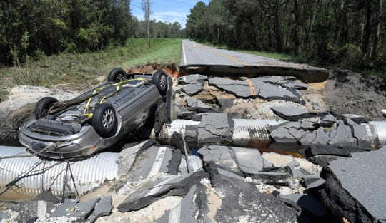 The scene of flood damage where the road was washed away on Williams Road in Duplin County on Tuesday, Sept. 18, 2018.