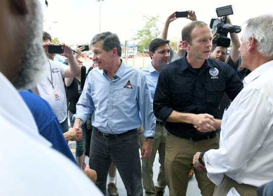 North Carolina Gov. Roy Cooper and FEMA administrator Brock Long greet officials before thanking first responders in Wilmington following Hurricane Florence in September. North Carolina, by its Constitution and modifications imposed by the General Assembly, has a weak governor form of government.
