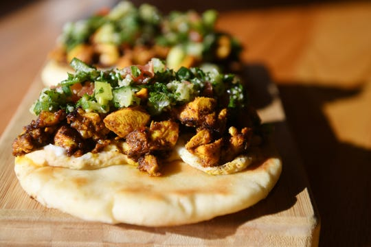The Scarlet Bee's chicken shawarma with ppiced Springer Mountain Chicken served on pita with hummus and tabbouleh.