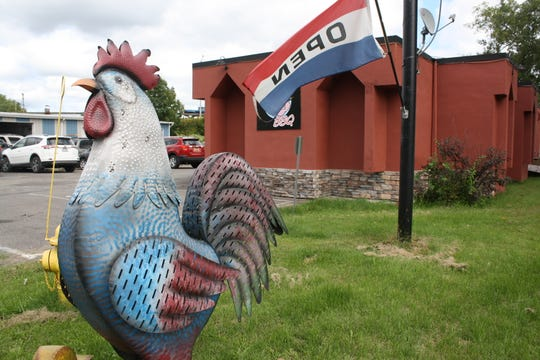 A metal rooster marks the location of Pinkies Barbecue, located on Upper Front Street in Binghamton.