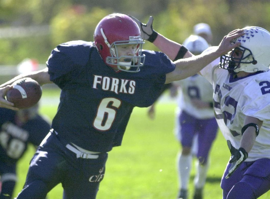 Chenango Forks' Tim Batty blocks Dryden's Corey Hollenbeck as he makes a run down the sideline in the first half the Saturday game.