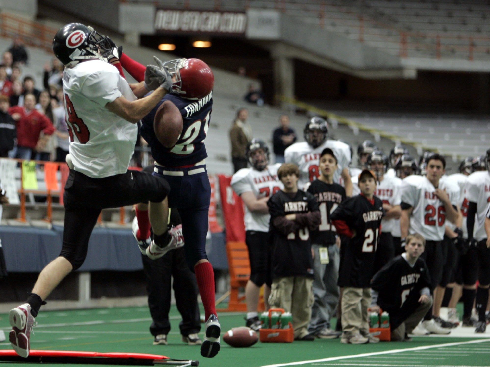 Rye's Tim Monaghan (88) can't pull in a pass as Chenango Forks' Ben Farnham (21) knocks the ball away in the final seconds of the second quarter during the Class B State Final at the Carrier Dome in Syracuse, N.Y. Nov. 26, 2004. Chenango Forks won, 48-0.