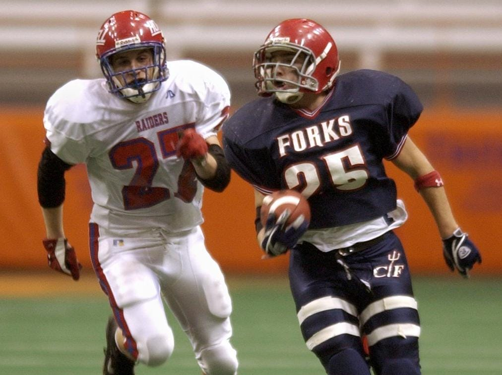 Chenango Forks' Jason Chier, right, is chased by Hornell's Chris Smith in the third quarter of their game Friday at the Carrier Dome in Syracuse.