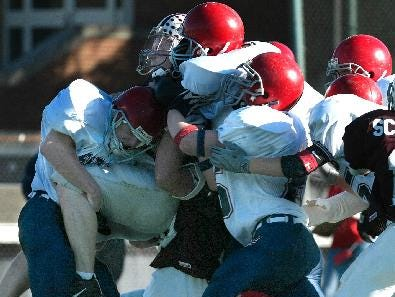 -  -Chenango Forks, #6, Tim Batty gives a lift to Eden, #20, Mark Schichtel in the second quarter at University of Rochester, Sunday.