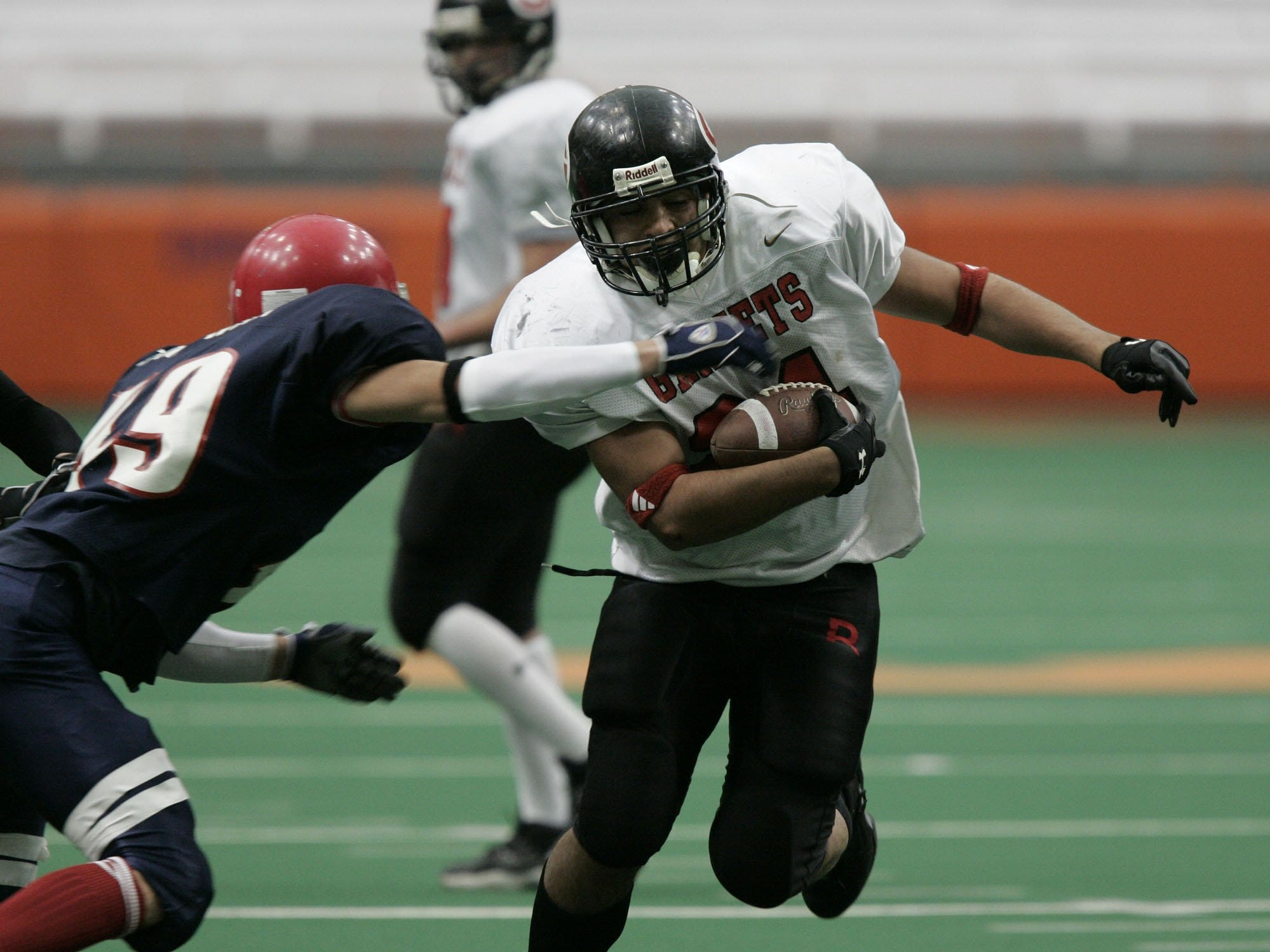 Rye's Robert Nieves (24) is tackled by Chenango Forks' Nick Tarnowski (49) during the Class B State Final at the Carrier Dome in Syracuse, N.Y. Nov. 26, 2004. Chenango Forks won, 48-0.