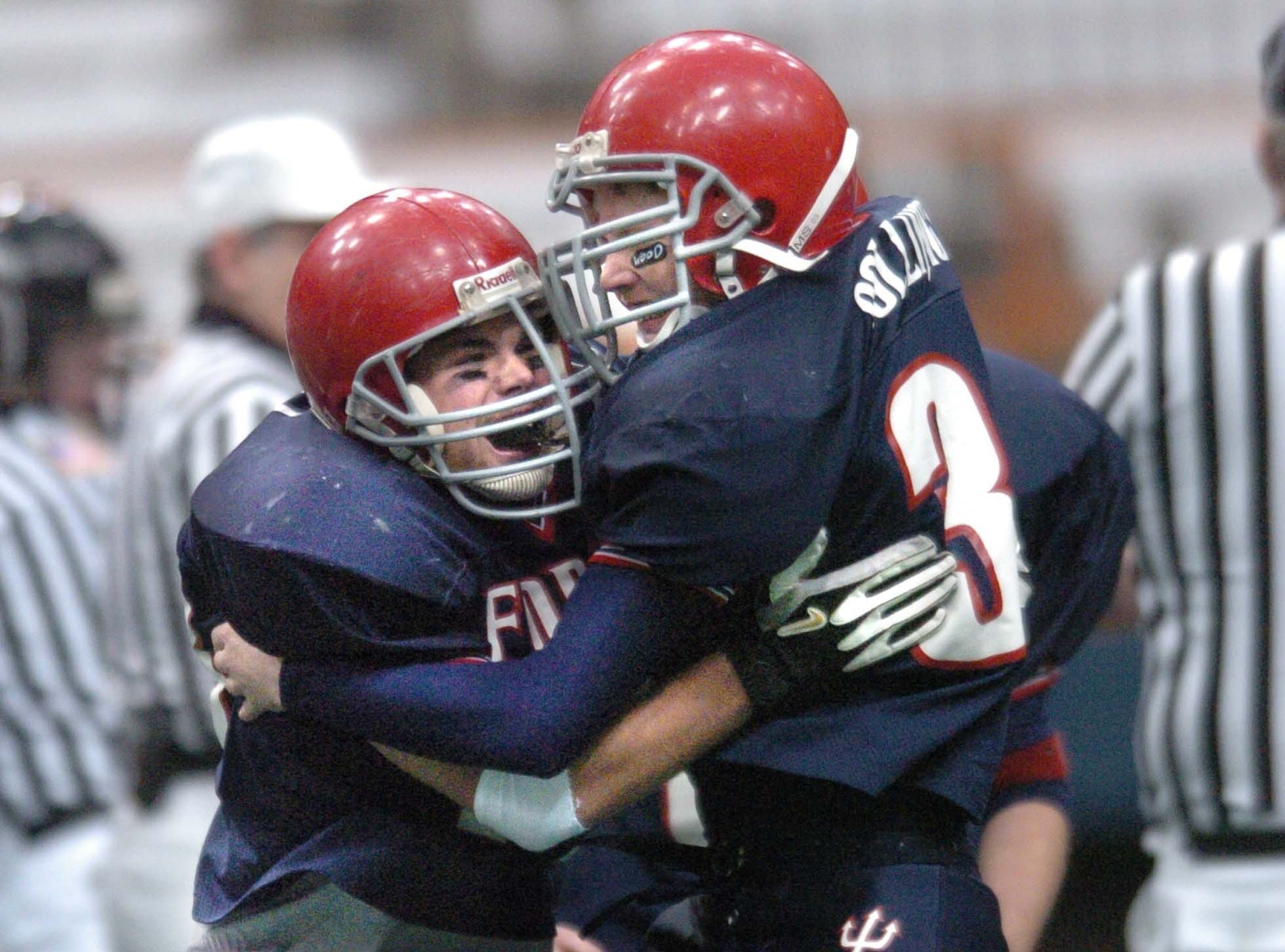 Chenango Forks' Luke Parga, left, and Ben Collingwood celebrate after Parga recovered an onside kick to start the second half in the Blue Devils' 48-0 win over Rye in the Class B title game.