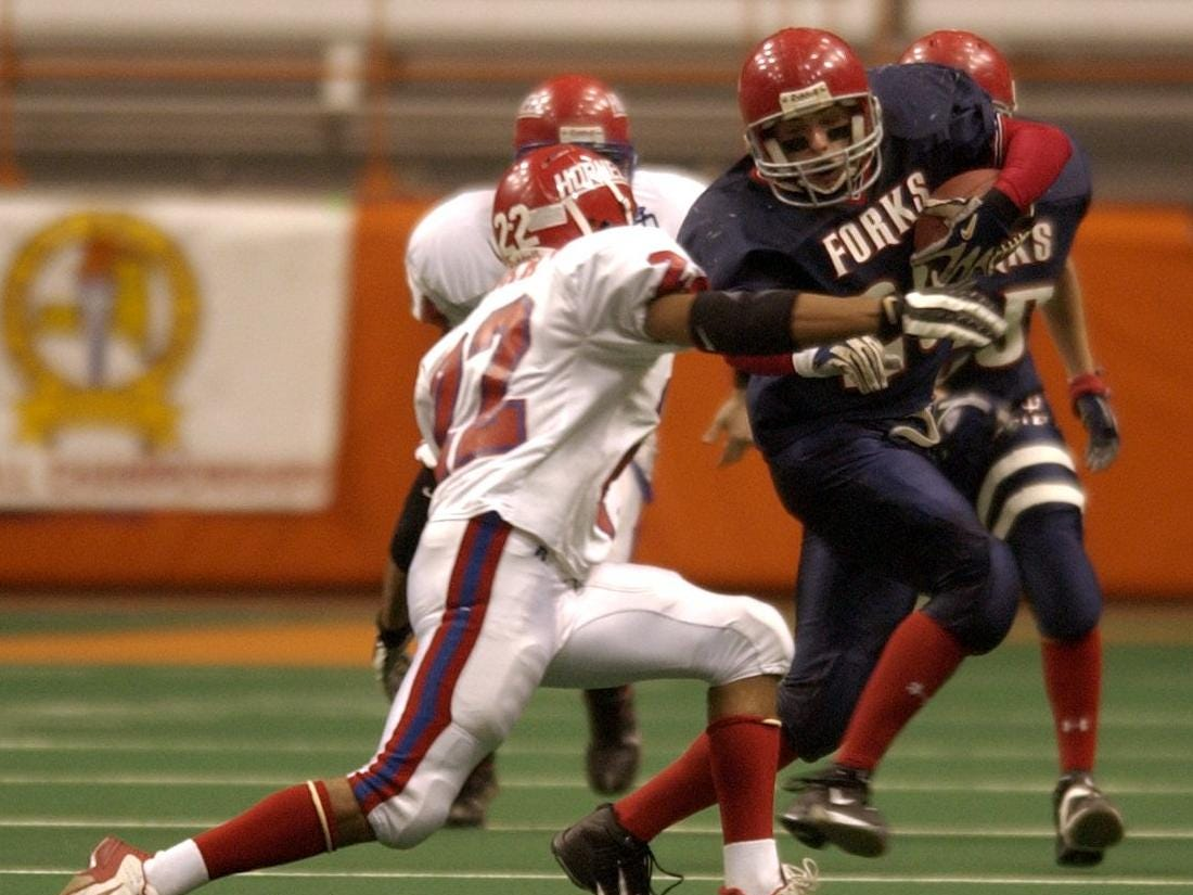 -  -Chenango Forks' Tim O'Branski, right, is tackled by Hornell's Matt Stewart in the second quarter of their game Friday at the Carrier Dome in Syracuse.