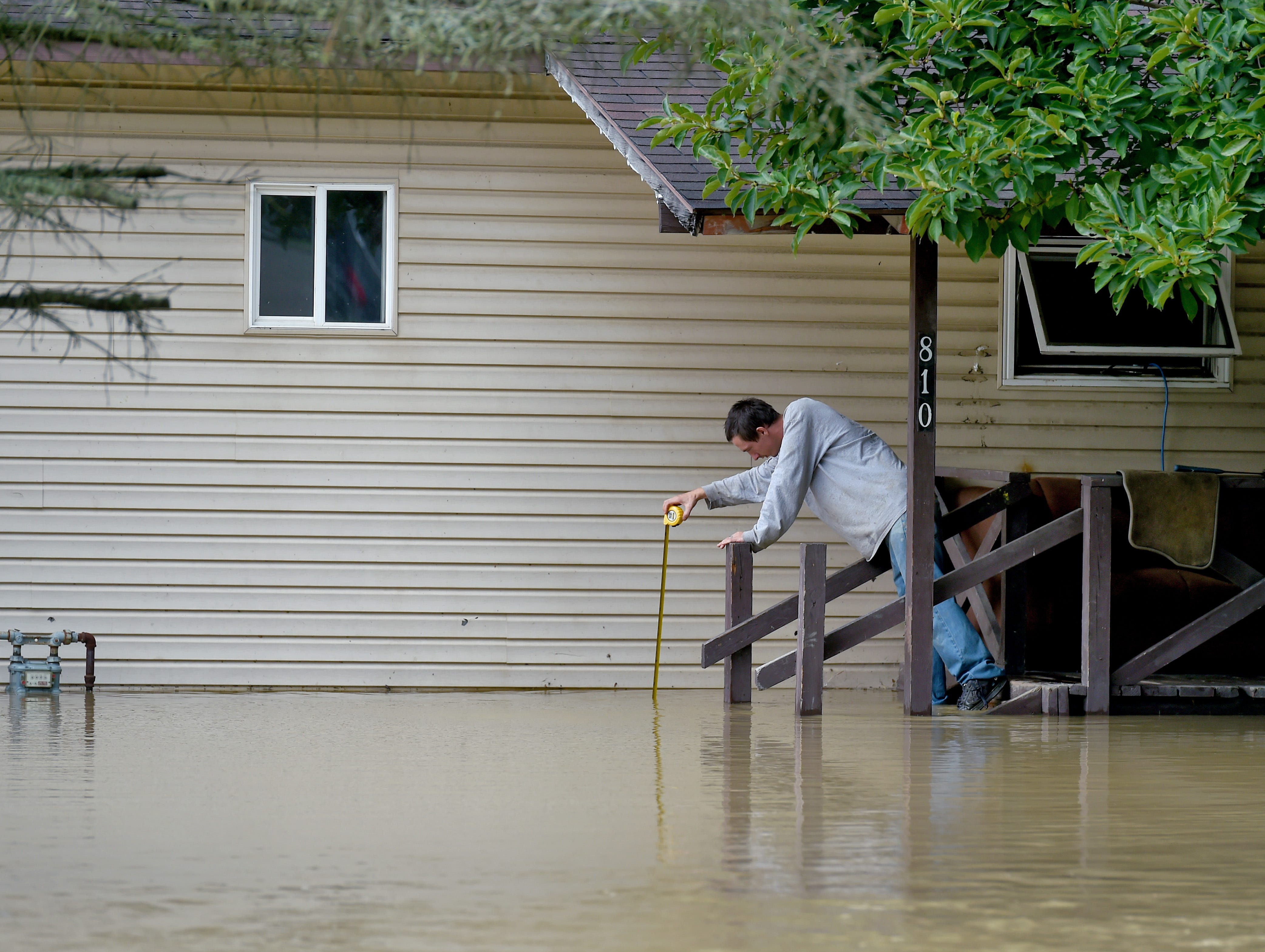 Mark Barber measures the flood waters from the porch of his rental property on Rt. 96 in Candor. Heavy rains caused flash flooding throughout parts of the Southern Tier on Tuesday, September 18, 2018. In Tioga County, a State of Emergency was declared as flash flooding closed roads and damaged property.