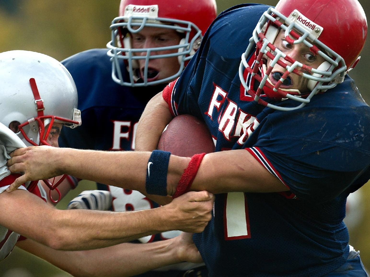 Chenango Forks #37, Joe Babcock gets yardage as he is being tackled by Chenango Valley #15, Greg Baxter in the second quarter at Chenango Forks High School.