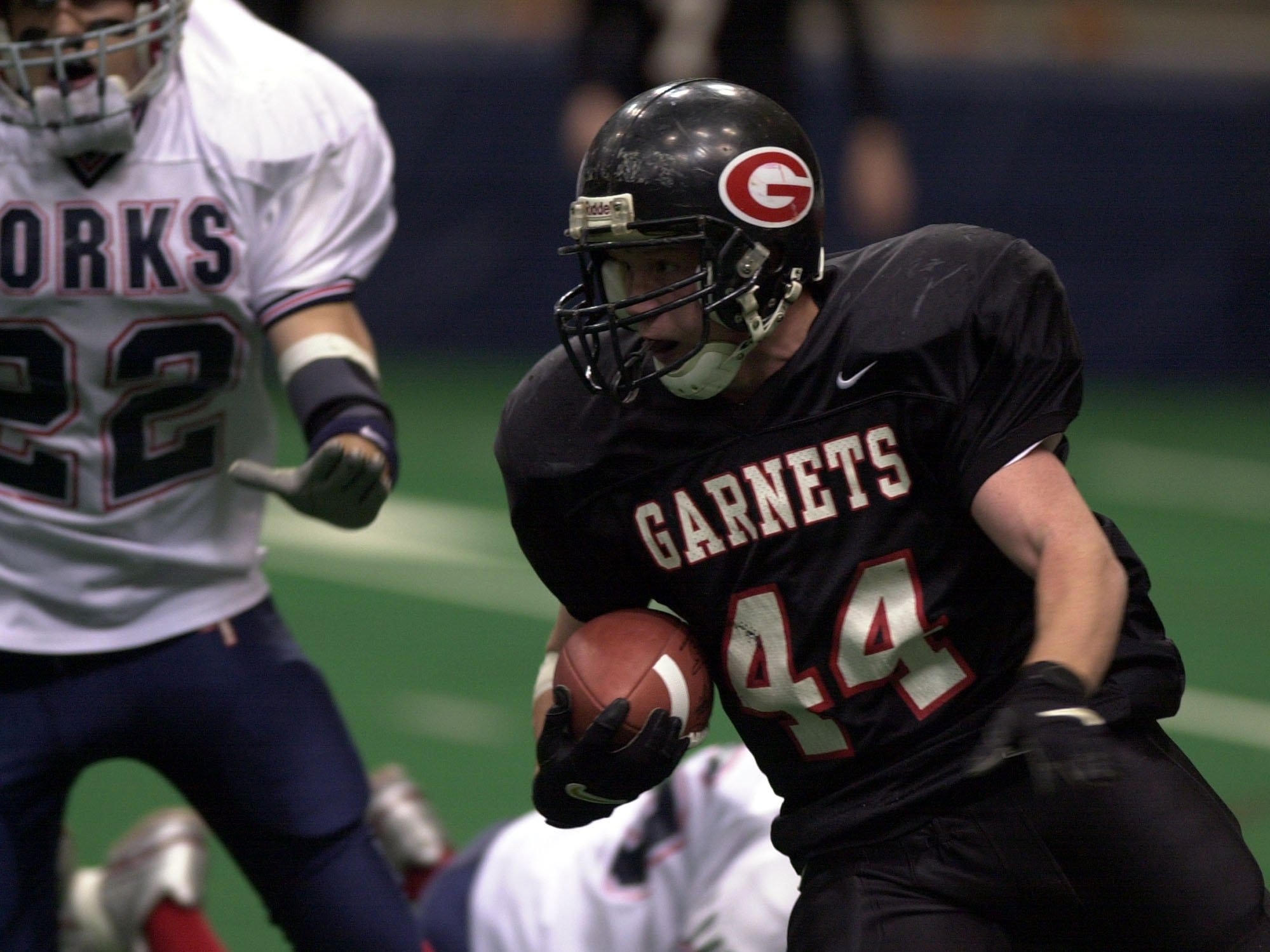 Rye's Steve Ramsey moves the ball in front of Chenango Forks Matt Stephens during the Class B state championship game between Rye High School and Chenango Forks High School, Nov. 29, 2003 at the Carrier Dome in Syracuse, N.Y.
