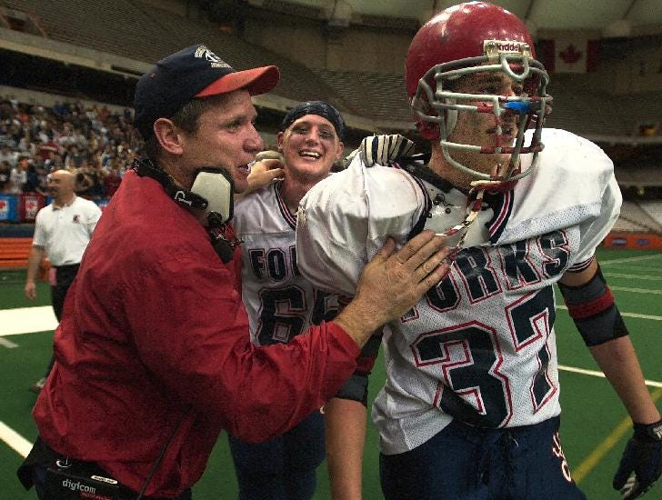 -  - Class B football champions Chenango Forks High School assistant coach, Dave Hogan with #65 Chris Pease and an emotional #37 Joe Babcock after winning against Rye High School, 16 to 0, Saturday at the Carrier Dome, Syracuse.