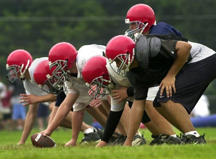 Chenango Forks High School's quarterback Kevin Purce with the offensive line during drills at practice.