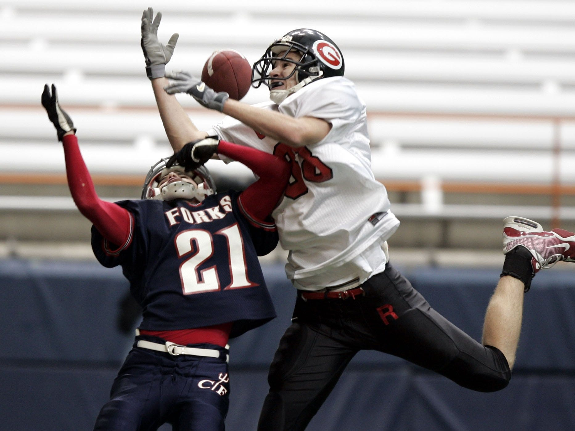 Rye's Tim Monaghan (88) knocks a pass away intended for Chenango Forks' Ben Farnham (21) during the Class B State Final at the Carrier Dome in Syracuse, N.Y. Nov. 26, 2004. Chenango Forks won, 48-0.