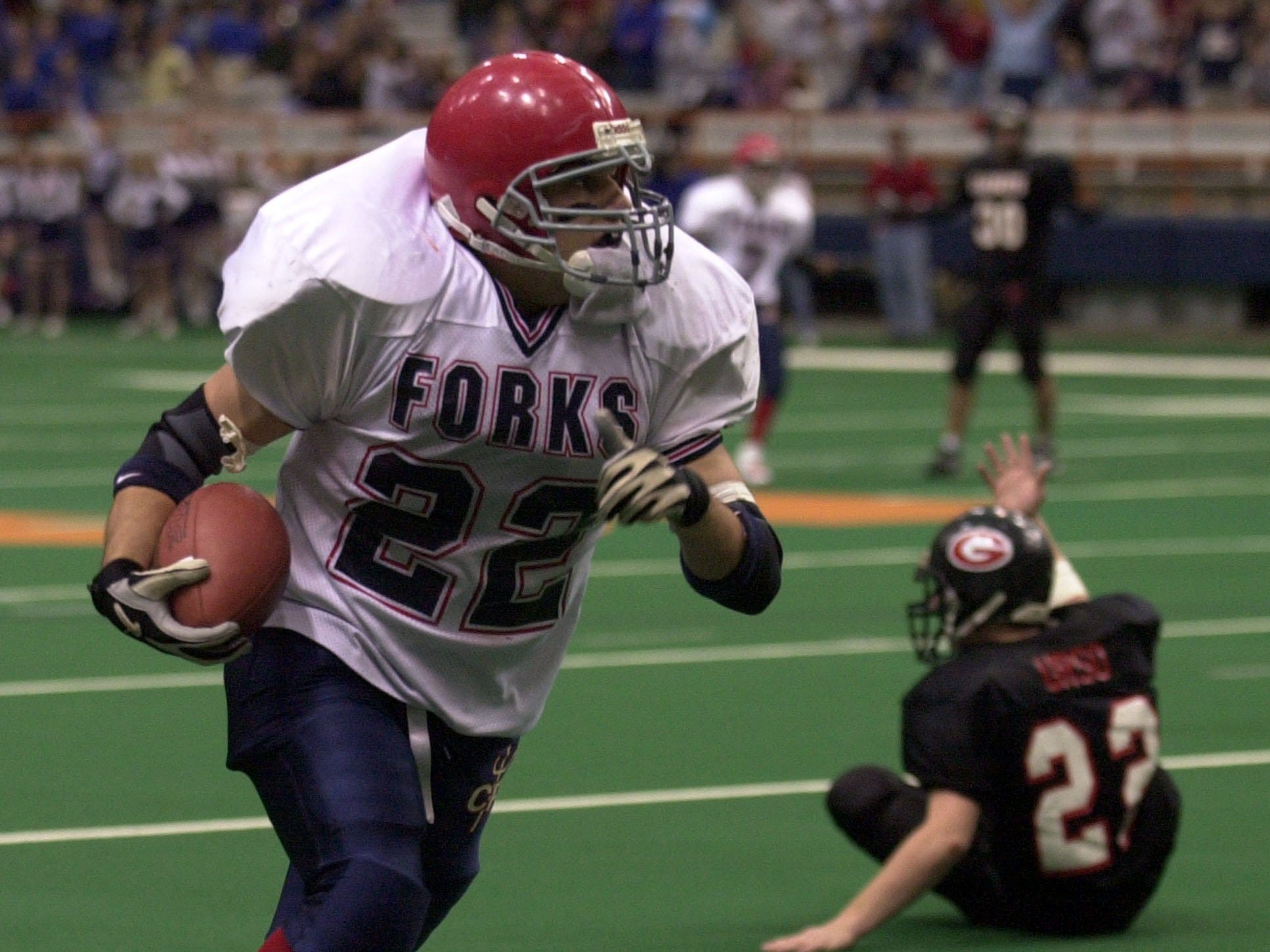 Chenango Forks Matt Stephens leaves Rye's Eddie Urso in his wake as he returns an interception for some yards during the Class B state championship game between Rye High School and Chenango Forks High School, Nov. 29, 2003 at the Carrier Dome in Syracuse, N.Y.